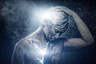 Grafik mit Körper, Blitzen, Lichtpunkten: Zusammenspiel Körper-Seele