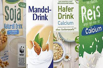 Vier Tetrapacks nebeneinander: Soja, Mandel, Hafer, Reisdrink