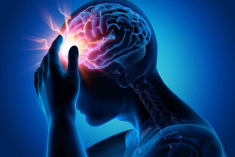 Grafik: Menschlicher Kopf mit rotem Lichtpunkt im Gehirn - Schlaganfall